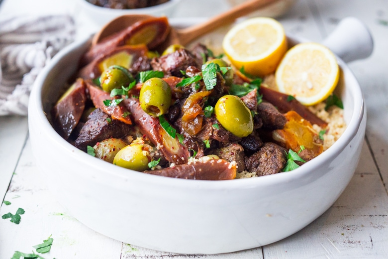 Instant Pot Lamb Tagine - meltingly tender, full of Moroccan flavors and only takes 35 minutes in the Instant Pot! | www.feastingathome.com #instantpot #lamb #lambtagine #lambstew