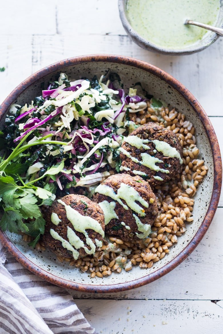 25 Lentil Recipes! | Vegan Lentil Cakes made with walnuts and mushrooms topped with flavorful Zhoug yogurt.