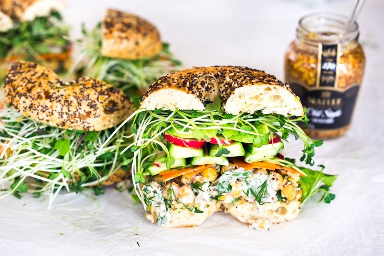 Vegan Green Goddess Sandwich with herby chickpea salad, crunchy carrots & radishes, cucumber, avocado and sprouts. Vegan and Gluten-free adaptable!