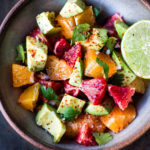 A simple delicious recipe for  Orange and Avocado Salad with Lime juice, chili flakes and cilantro.