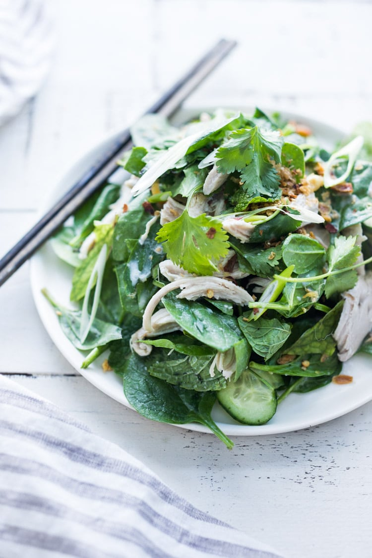 Thai Chicken Salad with baby spinach, spring herbs and scallions. A flavorful Thai-inspired Entree Salad. #coconutchicken #coconut #spinachsalad #thaisalad