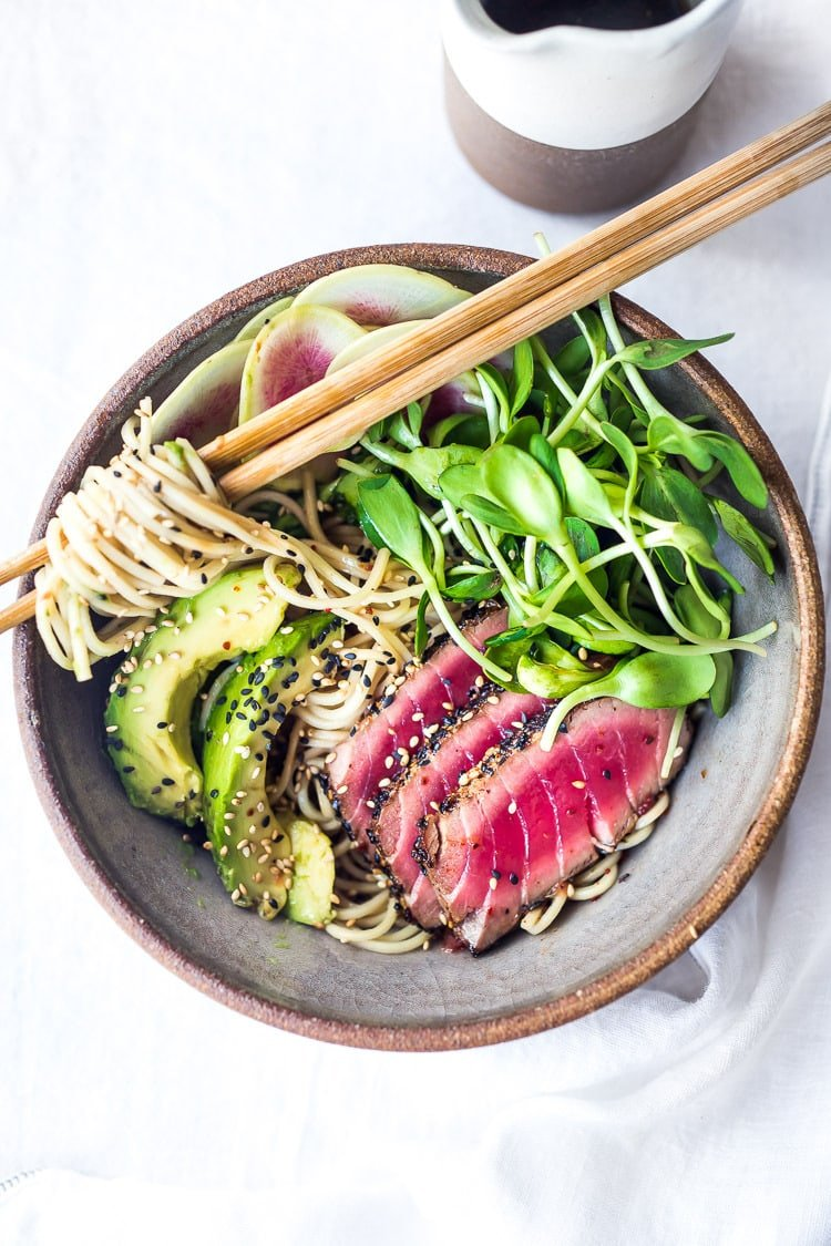 Asian Noodle Bowl- loaded up with fresh seasonal veggies and a delicious Ponzu Dressing, this healthy bowl can be made with seared ahi tuna or sesame ginger tofu. Vegan and Grain-free adaptable! ( Try it with zucchini noodles!)