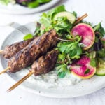 Grilled Lamb Kebabs with a tangy Herb Salad and Dilled Yogurt Sauce- a delicious, paleo friendly recipe featuring Middle Eastern flavors.