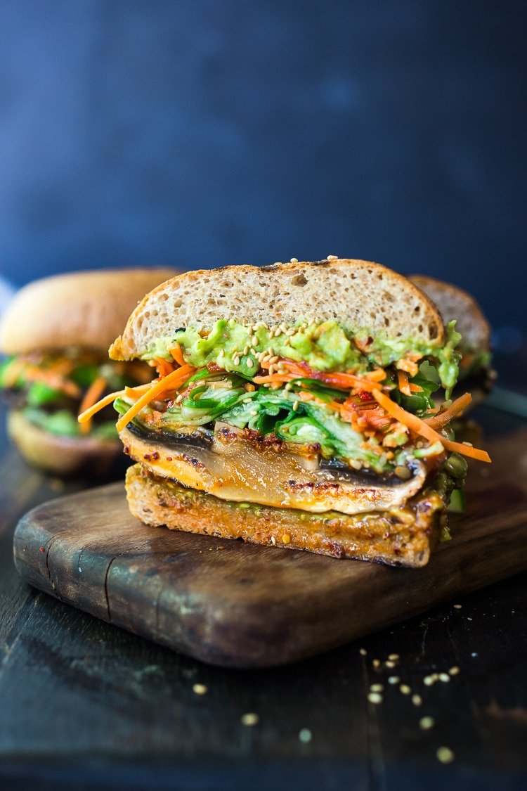 This Asian-style,grilled, vegan portobello mushroom burger isfull ofdeliciousumami flavor! It's lathered with Asian-style Guacamole, topped with a cool cucumber ribbon salad and crunchy carrot slaw. Healthy,delicious and reallysatisfying. AND totally vegan!#veganburger #portobelloburger #veganportobelloburger #portobellomushroomrecipes #portobello #vegan #veganburger #grilled #grilledportobello