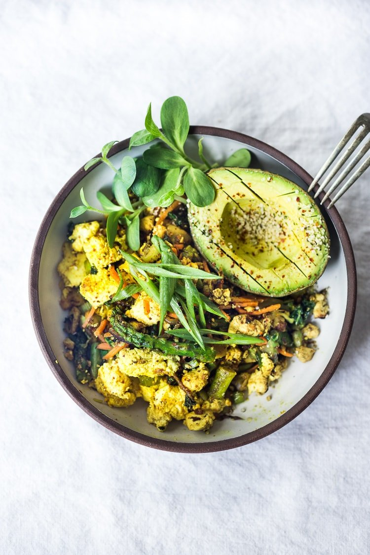 Vegan Tofu Scramble - loaded up with healthy seasonal veggies that you already have on hand. This vegan breakfast can be made in 15 minutes flat! Healthy, Fast, delicious! #vegan #veganbreakfast #tofuscramble #plantbased #eatclean #cleaneating #cleaneats