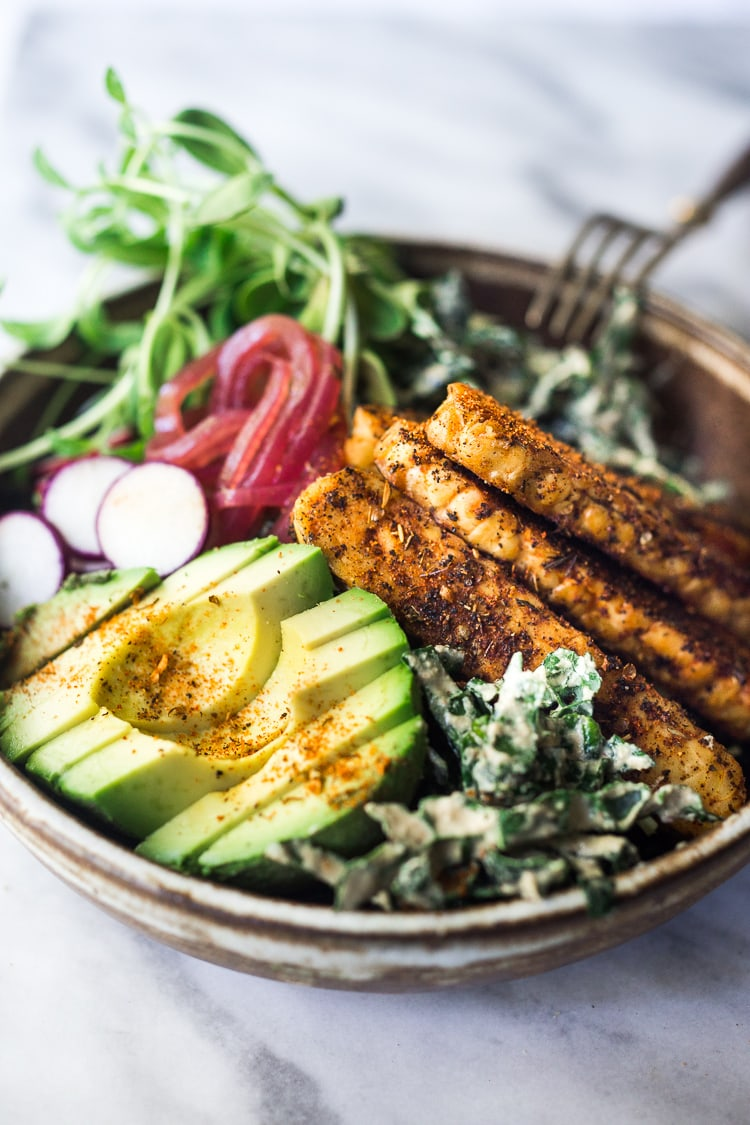 Blackened Tempeh with Avocado, Kale, Radishes, Pickled Onions and a Creamy VEGAN Cajun Ranch Dressing that can be made into a hearty entree salad, grain bowl, or packable wrap.  #tempeh #veganranch #vegan #glutenfree #healthybowl