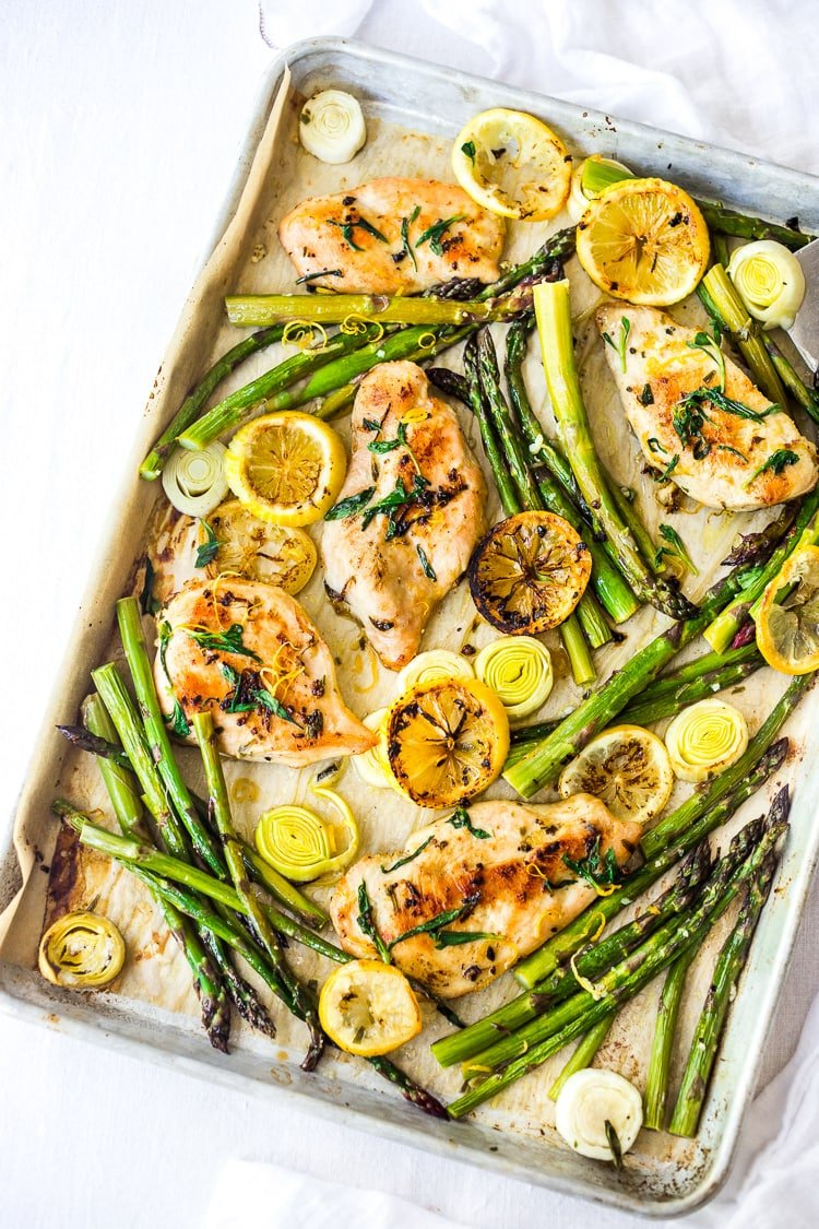 Tarragon Chicken with Asparagus, Lemon and Leeks - all roasted on a sheet pan for a fast and healthy dinner with minimal clean up! #tarragon #sheetpandinner #healthychicken #asparagus #leeks