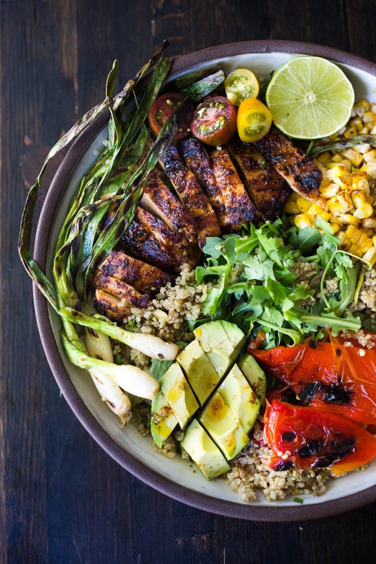 20 Healthy Summer Dinner Recipes! Healthy, Easy, Chipotle Grilled Chicken Salad with Grilled Corn, Peppers and Arugula, over a bed of optional quinoa with grilled scallions, avocado and a simple Chipotle Lime Dressing.  Sub MEXICAN TOFU for the Chicken for a vegan version! #chipotlechicken #mexicansalad #chickensalad #grilledchicken