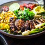 Healthy, Easy, Chipotle Grilled Chicken Salad with Grilled Corn, Peppers and Arugula, over a bed of optional quinoa with grilled scallions, avocado and a simple Chipotle Lime Dressing.  Sub MEXICAN TOFU for the Chicken for a vegan version!