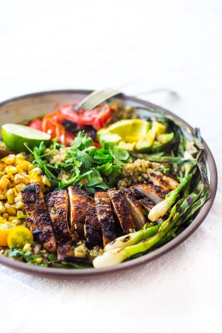 Healthy, Easy, Chipotle Grilled Chicken Salad with Grilled Corn, Peppers and Arugula, over a bed of optional quinoa with grilled scallions, avocado and a simple Chipotle Lime Dressing.  #chickensalad #grilledchickensalad #chipotle #salad #chicken #grilledchicken #quinoa #healthy #arugula