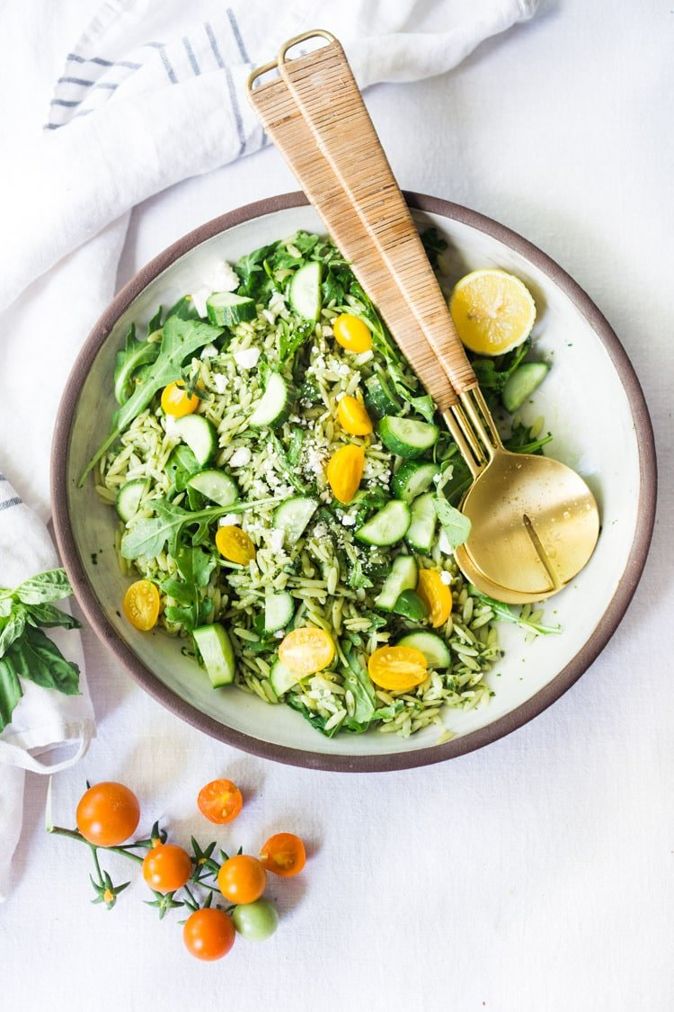 Lemon Basil Orzo Salad with cucumbers, tomatoes and arugula. A healthy, vegan pasta salad that can be made ahead for midweek lunches or potlucks. Keep it vegan or add feta! #orzo #orzosalad #orzopasta #pastasalad #vegan #orzorecipes
