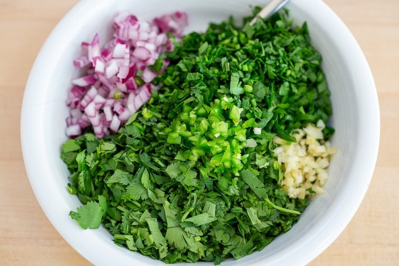 place Chimichurri ingredients in a bowl and mix