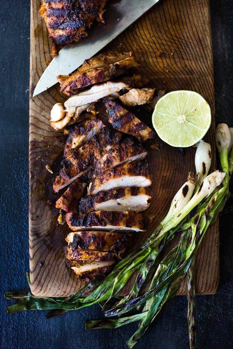 Smoky, spicy and delicious, this Mexican Grilled Chipotle Chicken  is bathed in the most flavorful marinade. Grill the chipotle chicken ahead and reheat on busy weeknights, or store it in the flavorful chipotle marinade, then fire up the grill after work. Use in healthy bowls, salads, tacos, or pasta. So EASY and oh so tasty!