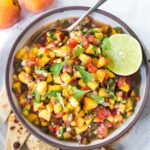 This Fresh Peach Salsa recipe is bursting with summer flavor! Delicious on its own with chips or serve over grilled fish or chicken. Simple and easy, make this when peaches are at their peak of flavor -fresh, juicy and ripe.#peachsalsa #peaches #peach #salsa #peachrecipe #peachsalsarecipe #salsarecipe