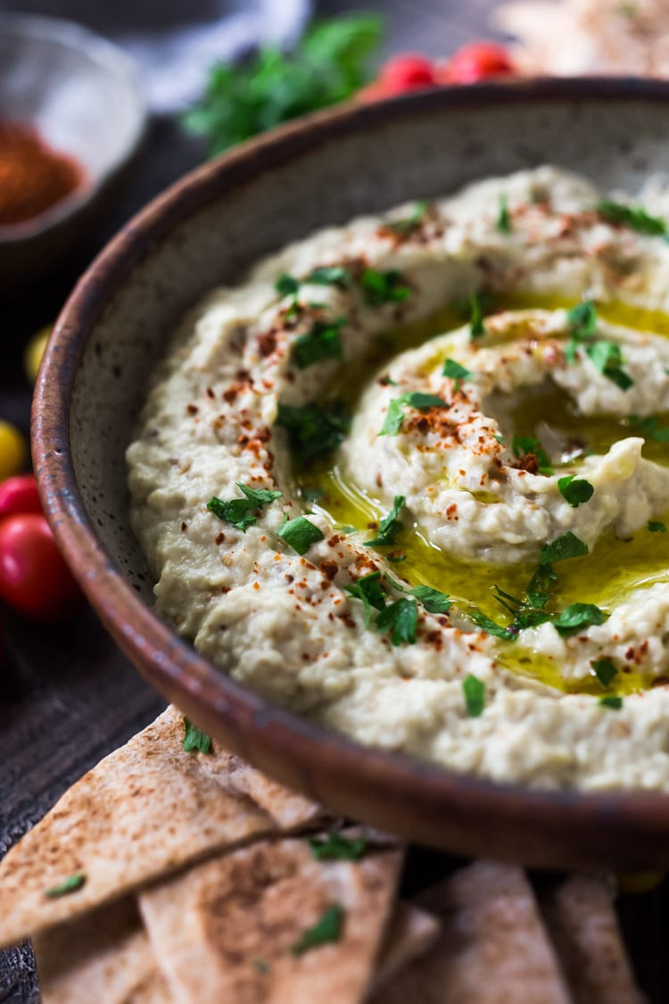 The BEST Baba Ganoush recipe made with smoky grilled eggplant, tahini, garlic and lemon. A healthy, delcious Middle Eastern Eggplant Dip that is full of complexity and depth. Gluten-free, low-carb, vegan. #baba #babaganoush #eggplant #paleo #lowcarb #keto #vegan