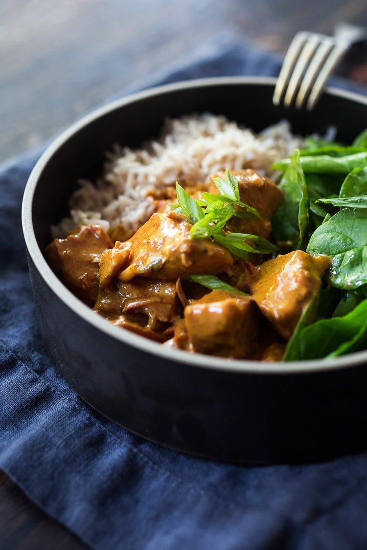 Instant Pot Tikka Masala, made with chicken or kept VEGAN with coconut milk, chickpeas and veggies. Serve over basmati rice, or, for a low-carb, paleo version, serve it over a bowl of baby spinach! #paleo #healthy #tikkamasala #weeknightdinner #instantpottikkamasala #instantpot #chickentikkamasala #vegetariantikkamasala #vegan #instantpotchicken #instantpotchickenrecipes #keto