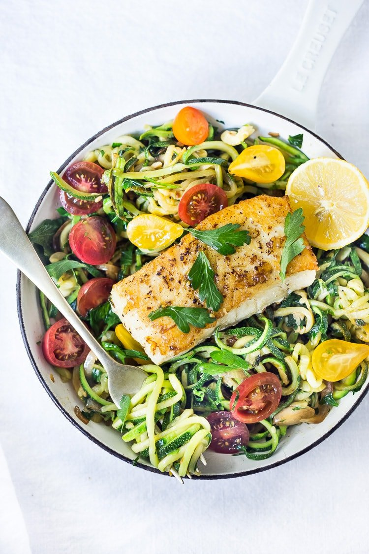 A simple, healthy Halibut recipe served over Lemony Zucchini Noodles with olive oil, garlic and Italian parsley, topped with sweet summer tomatoes. A quick and easy low-carb meal!
