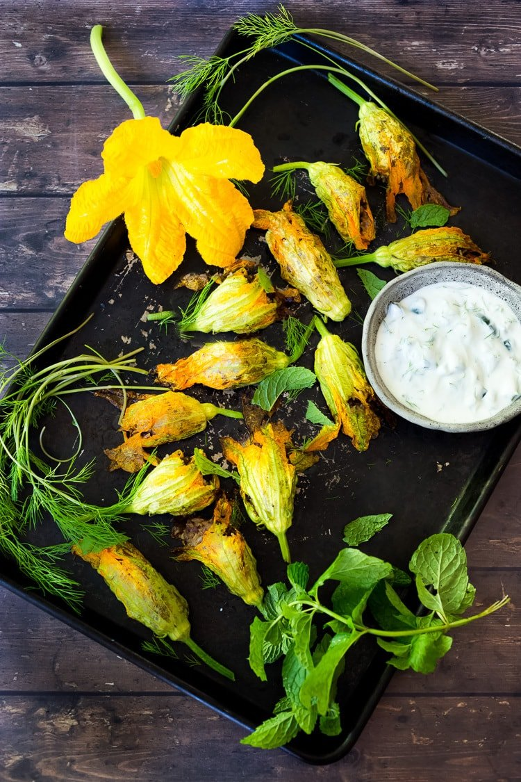 Baked Stuffed Squash Blossoms (Dolmas Style!)with ground lamb, basmati rice and fragrant Middle Eastern spices- a simple delicious main course or appetizer, inspired by the season! #dolmas #squashblossom #zucchiniblossom #squashblossoms #stuffedsquashblossom #baked #keto #paleo #lamb #lambrecipes #groundlamb