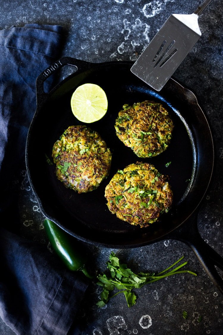 A simple healthy recipe for Zucchini Cakes with Jalapeño and Lime, topped with Chipotle Aioli. Serve this with a leafy green salad for a flavorful vegetarian meal! #zucchinifritters #zucchinicakes #zucchinirecipes