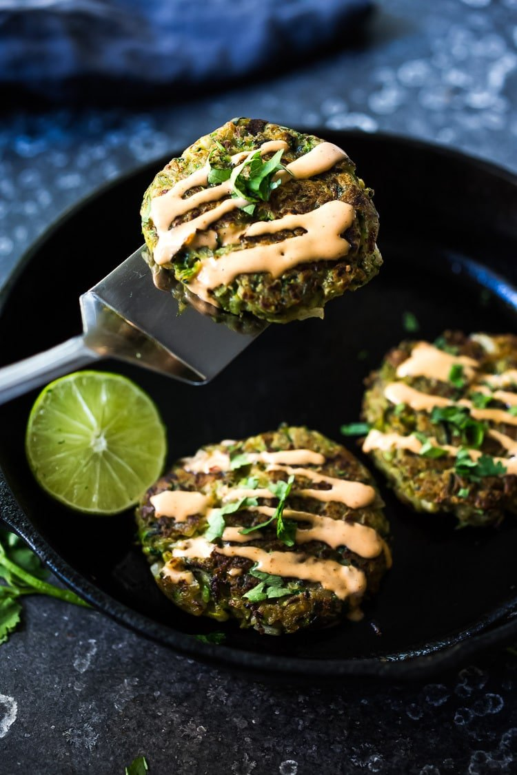 Zucchini Cakes with Jalapeño and Lime, topped with Chipotle Aioli. Serve this with a leafy green salad for a flavorful vegetarian meal! #zucchinifritters #zucchinicakes #zucchinirecipes