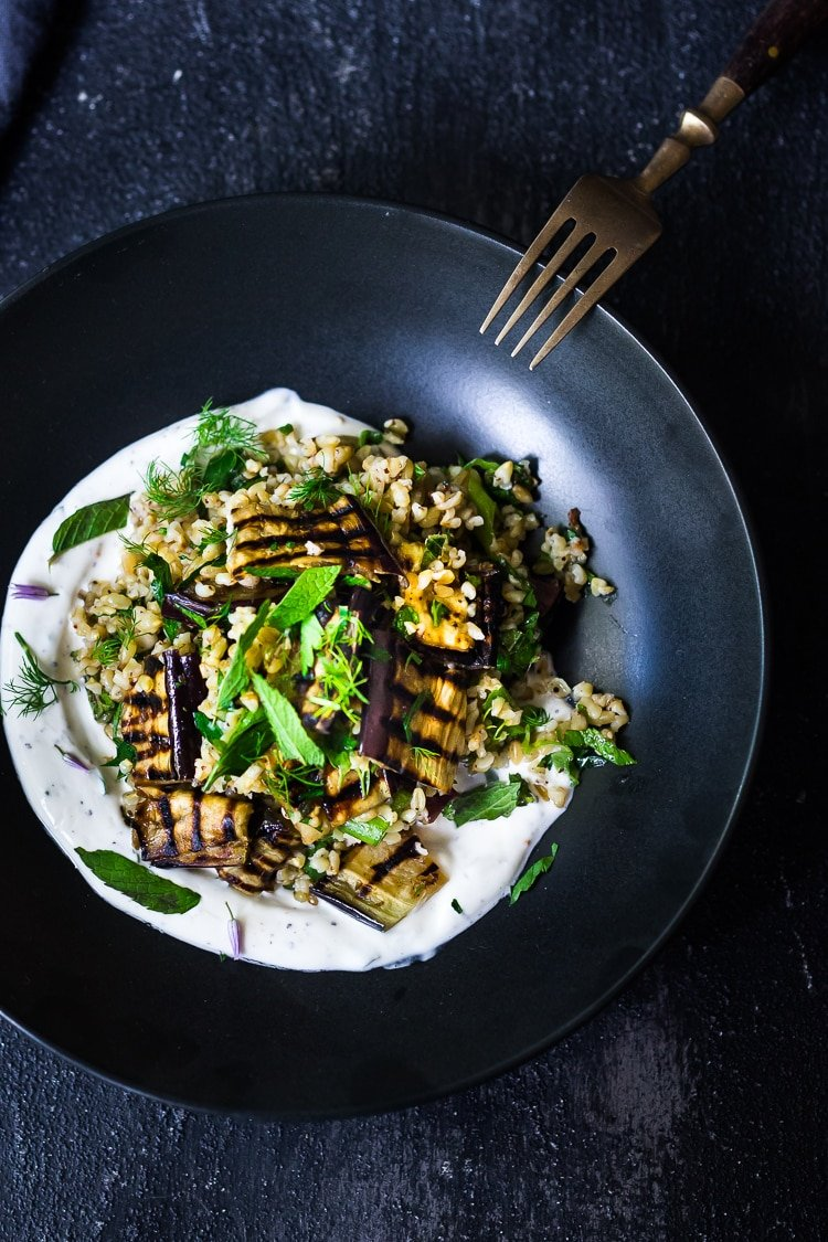Grilled Eggplant Salad with Freekeh, fresh herbs and a tangy yogurt dressing. A delicious Middle Eastern salad that can be made ahead. Vegan adaptable! #freekeh #eggplantsalad