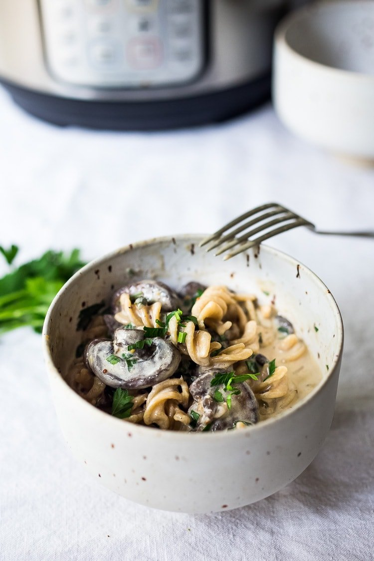 Instant Pot Mushroom Stroganoff - a simple, easy vegetarian weeknight dinner that is creamy, hearty and full of delicious depth and flavor!  Vegan Adaptable! #vegetarian #stroganoff #mushroompasta #veganpasta #instantpotrecipes #instantpot #healthtypasta