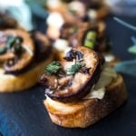 Mushroom Bruschetta with Triple Cream Brie, Sage and Truffle Oil - a surprisingly easy appetizer that tastes amazing and looks elegant! Perfect for holiday gatherings. #mushroombruschetta #mushroomappetizer #appetizer #holidayparty #holidayappetizer
