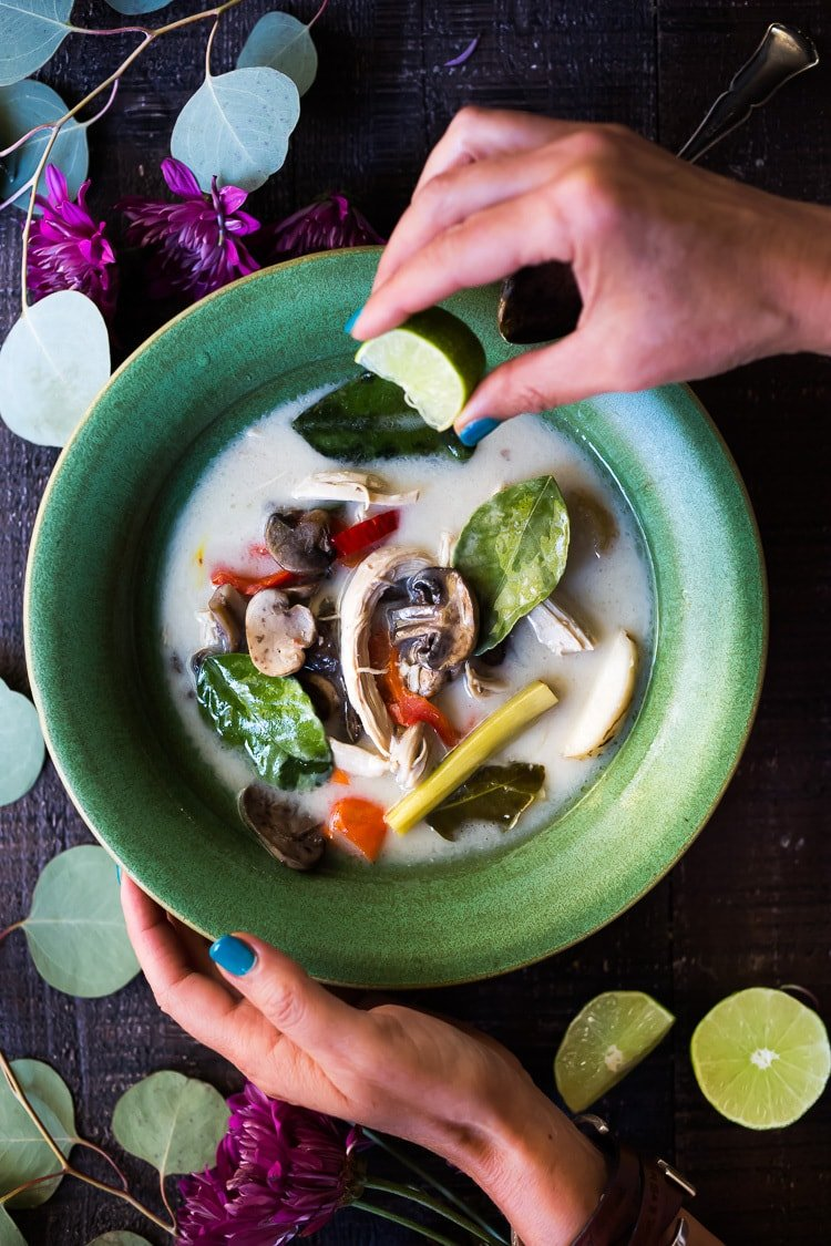 Our Top 20 Thai Recipes!| Authentic Tom Kha Gai (Thai Coconut Chicken Soup), an healthy, paleo recipe that can be made in an instant pot. Gluten-free and Vegan Adaptable! #tomkha #thaisoup #tomkhagai #chickensoup #instantpot