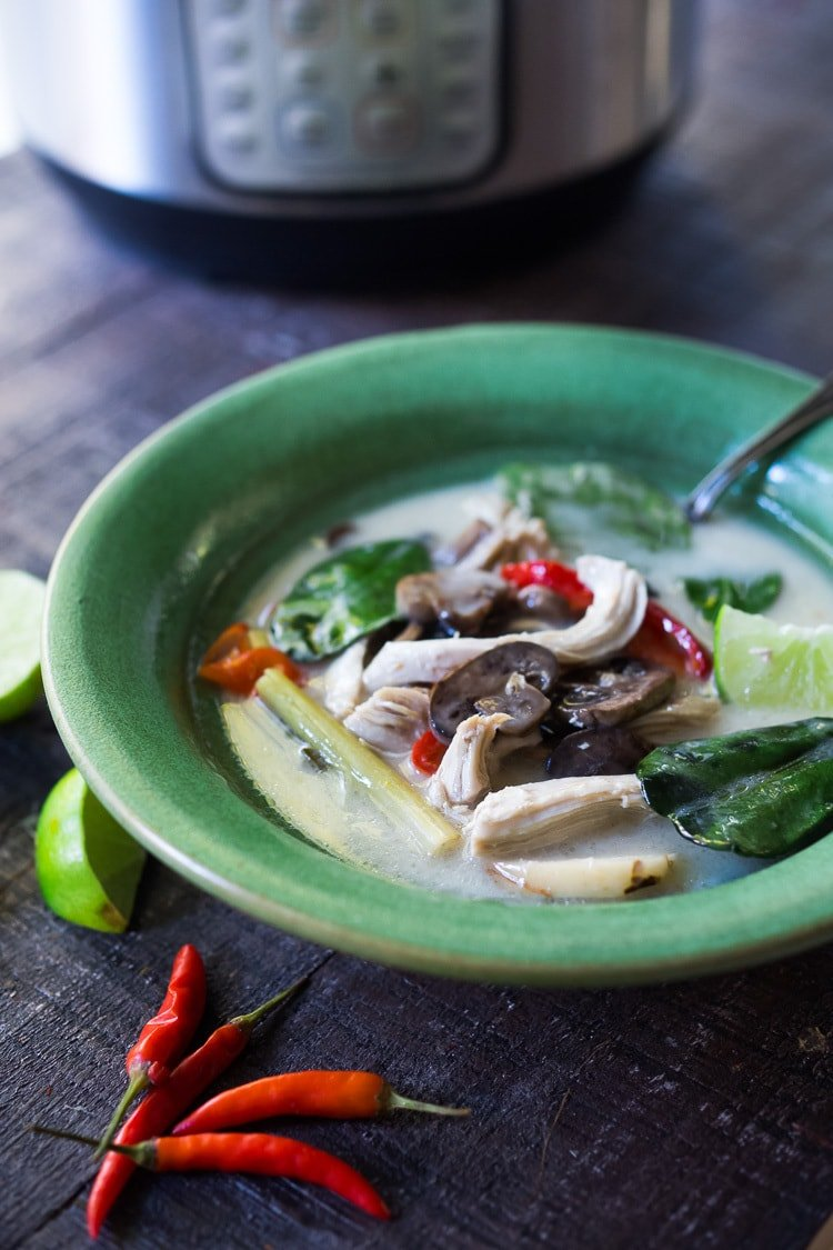 Authentic Tom Kha Gai Soup (Thai Coconut Chicken Soup) - a healthy, delicious and easy recipe that can be made in an Instant Pot or on the stove top. Vegan Adaptable! #tomkha #thaisoup #tomkhagai #paleo #keto #thaichickensoup #galangal #coconutsoup #traditional