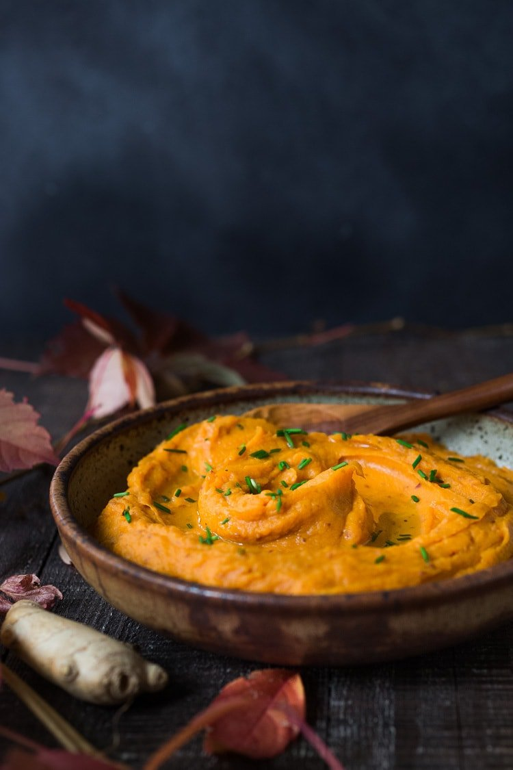 A quick and healthy recipe for Whipped Sweet Potatoes with Ginger - a flavorful vegan side dish that pairs well with fish, chicken or vegan mains. Silky and luscious, these flavorful sweet potatoes can be made in under 30 minutes! #sweetpotatoes #vegan #healthy #mashed