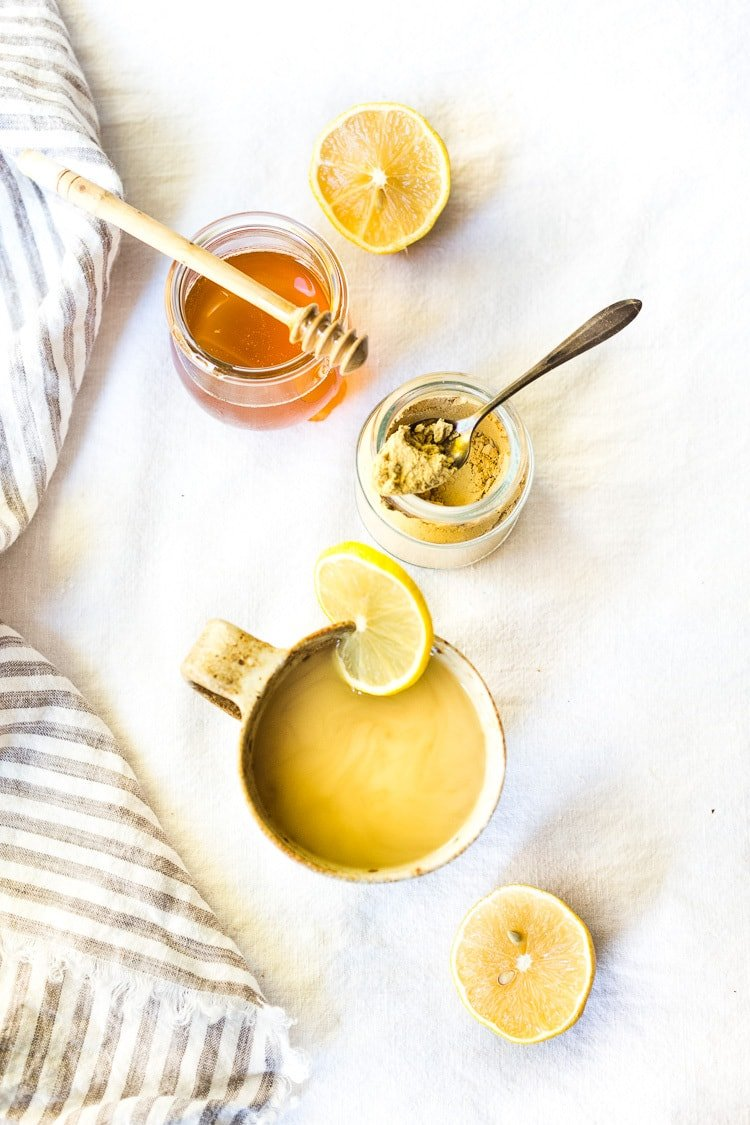 Sore Throat Tea! A homemade tea for sore throat- originating from Morocco, with just three ingredients- lemon, ginger and honey. This healthy, soothing tea remedy is so warming and comforting, you'll want to drink it all winter long! #tea #sorethroatremedy #remedy #tea #gingertea #sorethroattea