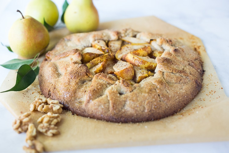 Rustic Pear Galette with Walnut Crust - a cozy fall dessert that is easy to make-  perfect for fall gatherings, holidays and parties. A delicious rustic tart that can be made ahead. #peartart #peardessert #pearrecipes #falldessert #dessert