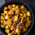 North Indian Butternut and Potato Curry, served over fluffy Basmati Rice. Subtle flavor, soothing and comforting. | #indiancurry #vegetarian #butternut #aloo #rajisthanifood #potatocurry #currypotaotes