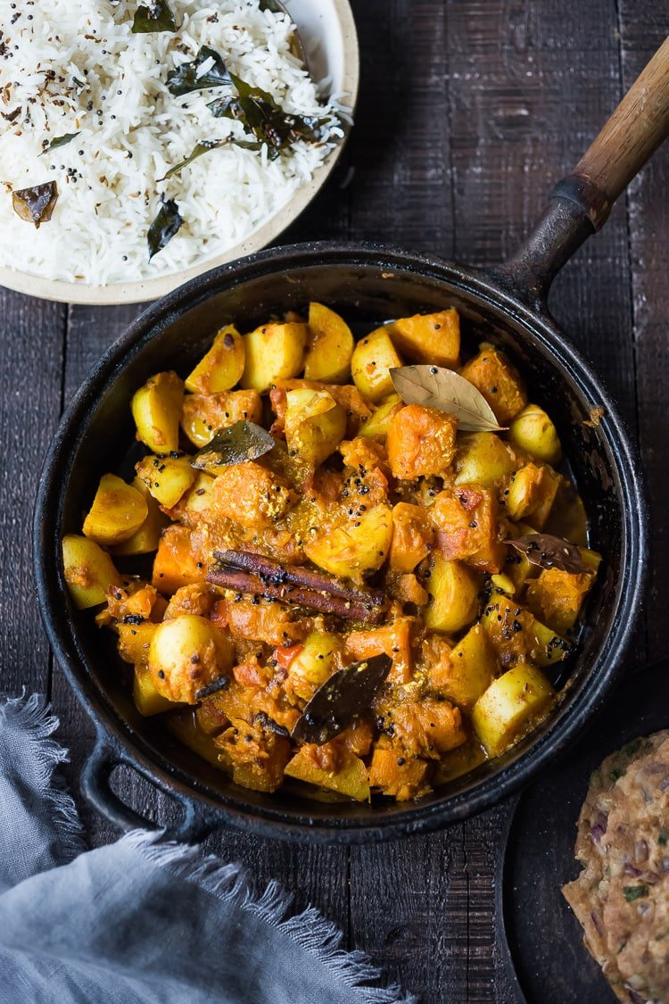 A soothing and comforting North Indian Butternut and Potato Curry hailing from Rajasthan, featuring winter squash and potatoes, using whole spices and ghee, served over fluffy basmati rice. | #pumpkincurry #potatocurry #aloo #butternutcurry #rajisthani #kaddu #curriedpotatoes #vegetarain #indianfood