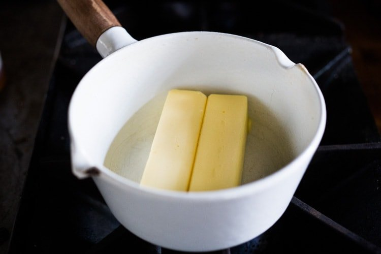 How to make ghee, a simple process that turns butter into the most flavorful foundation for authentic Indian cooking. Removing the milk solids out of butter makes it highly digestible, soothing to the body and according to Ayurvedic medicine, helps balance out the 3 doshas with many health benefits. #ghee #homemadeghee #gheebenifits #gheeuses #howtomakeghee #
