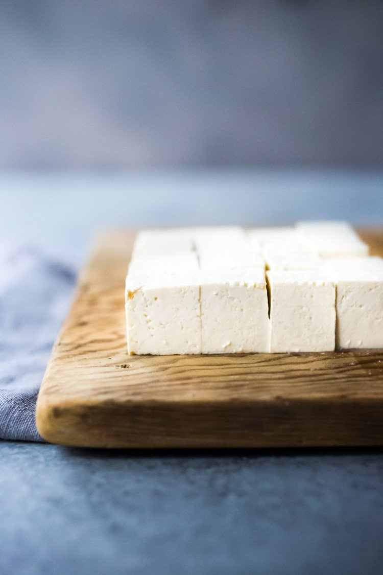 How to make Paneer at home - a fresh Indian Cheese that can be made in under an hour! Use in Indian curry, masala, wraps and stews! Easy, step by step recipe! #paneer #howtomakepaneer #homemadepaneer #paneerrecipe #easypaneer #vegetarian #indiancuisine #indianrecipes