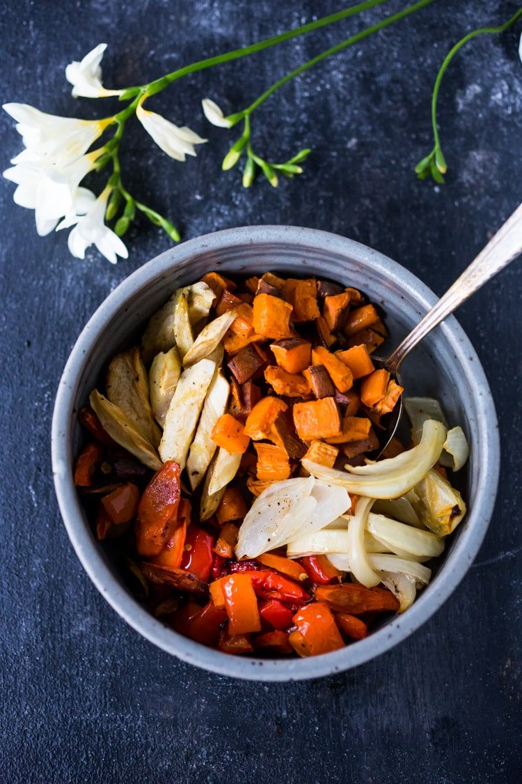 The secret to making Simple Roasted Veggies in the oven that come out perfect every time. Easy, healthy, delicious! Vegan and Gluten-free. #roastedveggies #roastedvegetables #bakedvegetables #vegan #healthy #veganside #glutenfree #feastingathome #sheetpanvegetables