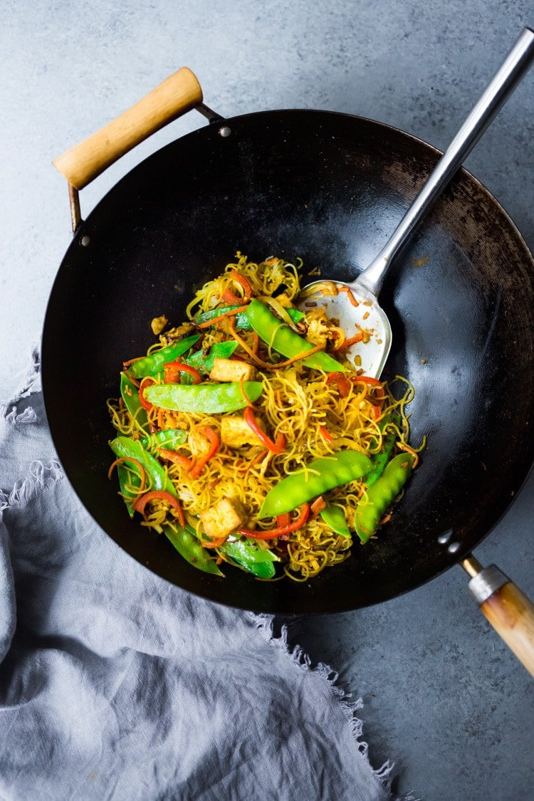 Singapore noodles— stir-fried rice noodles with curry, tofu and vegetables—a Chinese take out menu classic - easy recipe, vegetarian and full of authentic flavor! #meifun #singaporenoodles #currynoodles #chinesenoodles #stirfry #stirfrynoodles #vegetarian #noodles