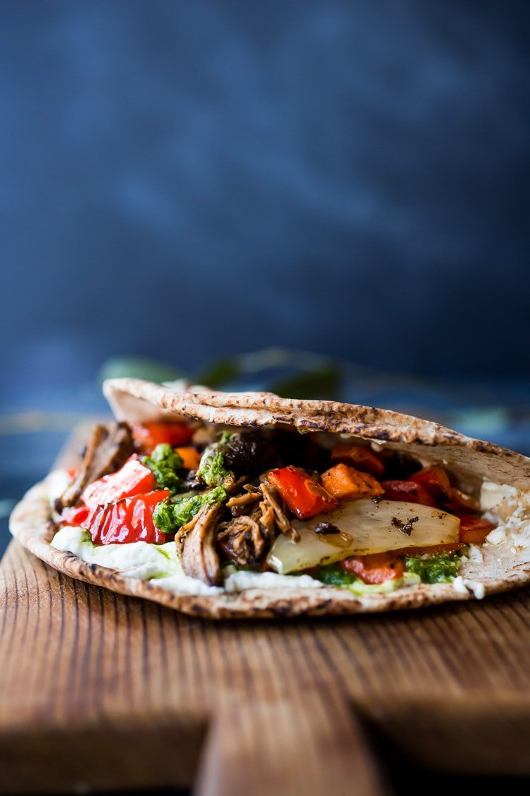 The best recipe for Lamb Shawarma- tender, juicy, leg of lamb, slow roasted in the oven with Middle Eastern Spices until falling apart. Serve this with rice and veggies, or in a pita or wrap! #lambrecipe #Shawarmarecipe #lambshawarmawrap #lambshawarma #fanoflamb #shawarma #authenticshawarma #