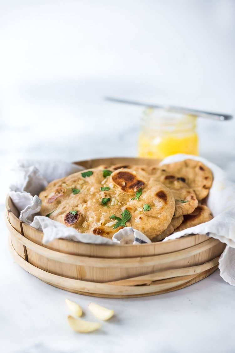 Easy Naan Recipe- simple step by step instructions to making traditional, pillowy, crispy naan bread in a skillet with all your favorite toppings - garlic naan, onion naan and seeded naan! #feastingathome #naan