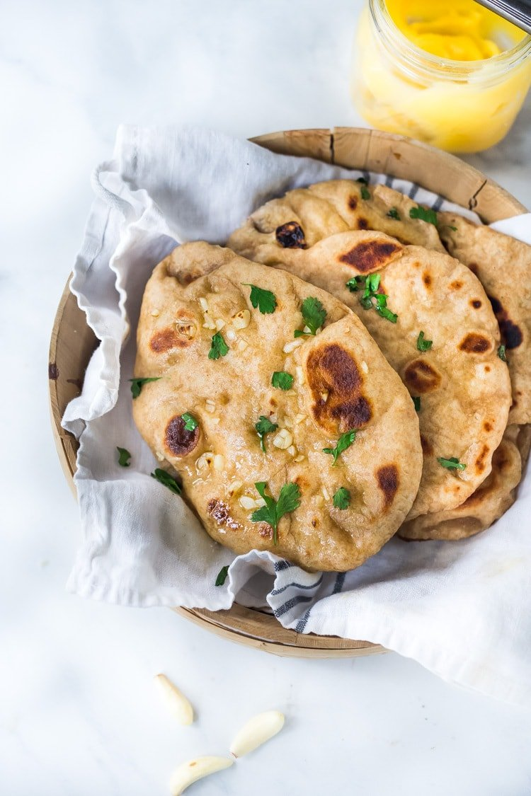 Quick EASY Naan Recipe - step by step instructions to making traditional Naan in a skillet - soft, pillowy and crispy- with all your favorite toppings- garlic naan, onion naan and seeded naan! #feastingathome #naan #naanbread #indianfood #wholewheatnaan #garlicnaan #onionnaan #indianbread #indianrecipes