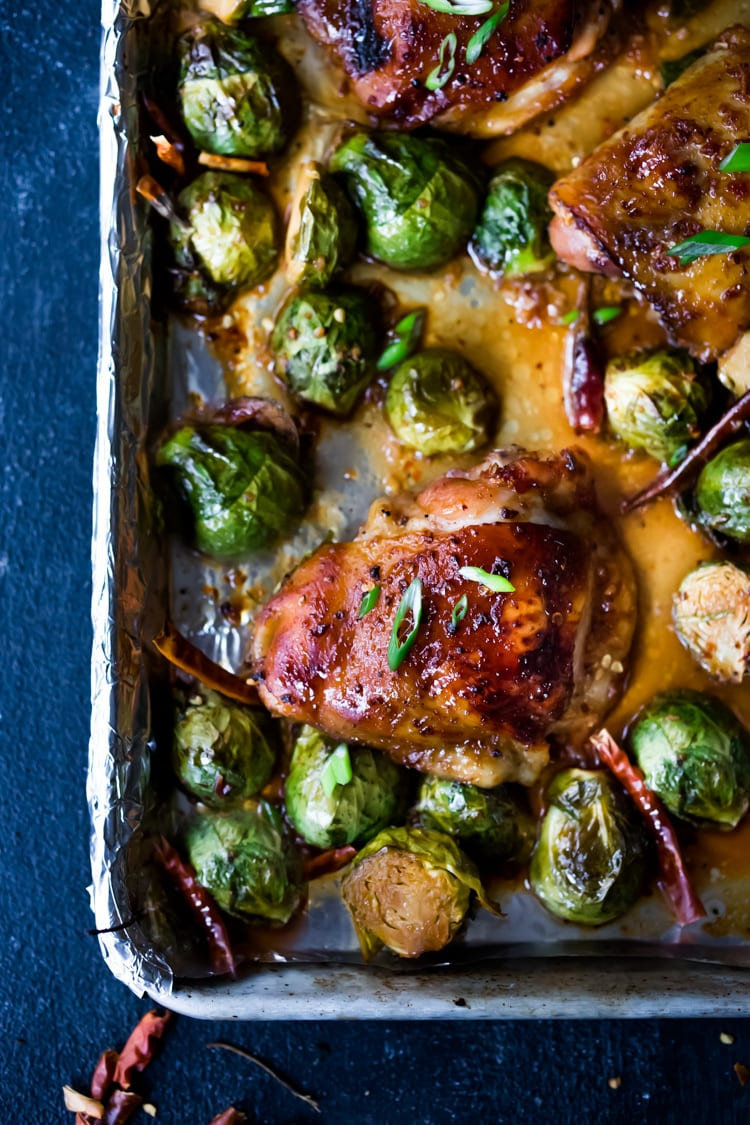Sheet-Pan Szechuan Chicken (or Tofu) with Brussel Sprouts takes only 15-20 minutes of hands on time before baking in the oven. A full-flavored weeknight dinner your whole family will love! #sheetpandinner #szechuanchicken #szechuan #szechuansauce #sheetpanchicken #roastedbrusselsprouts