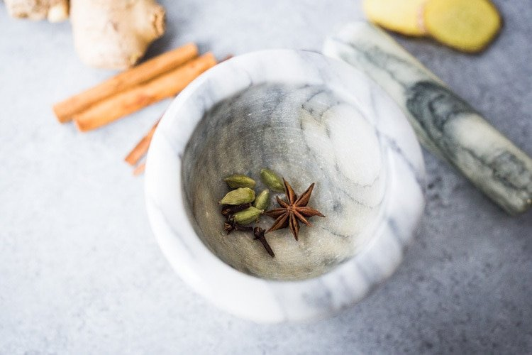 How to make authentic Masala Chai, like they do in India, using using whole spices. Vegan and Sugar Free adaptable. #chai #chaitea #masalachai #howtomakechai #masala