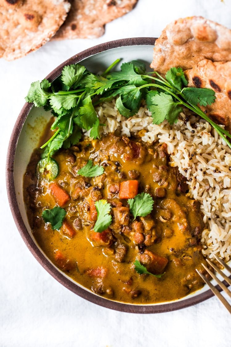 This Creamy Coconut Lentil Curry can be made in an Instant Pot or on the stove top. Infused with fragrant Indian spices, this recipe is not only delicious, it is is vegan and gluten free! #currylentils #indianlentils #lentilcurry #veganlentilcurry #instantpot #vegan #vegancurry #veganlentils #eatclean #cleaneating #plantbased
