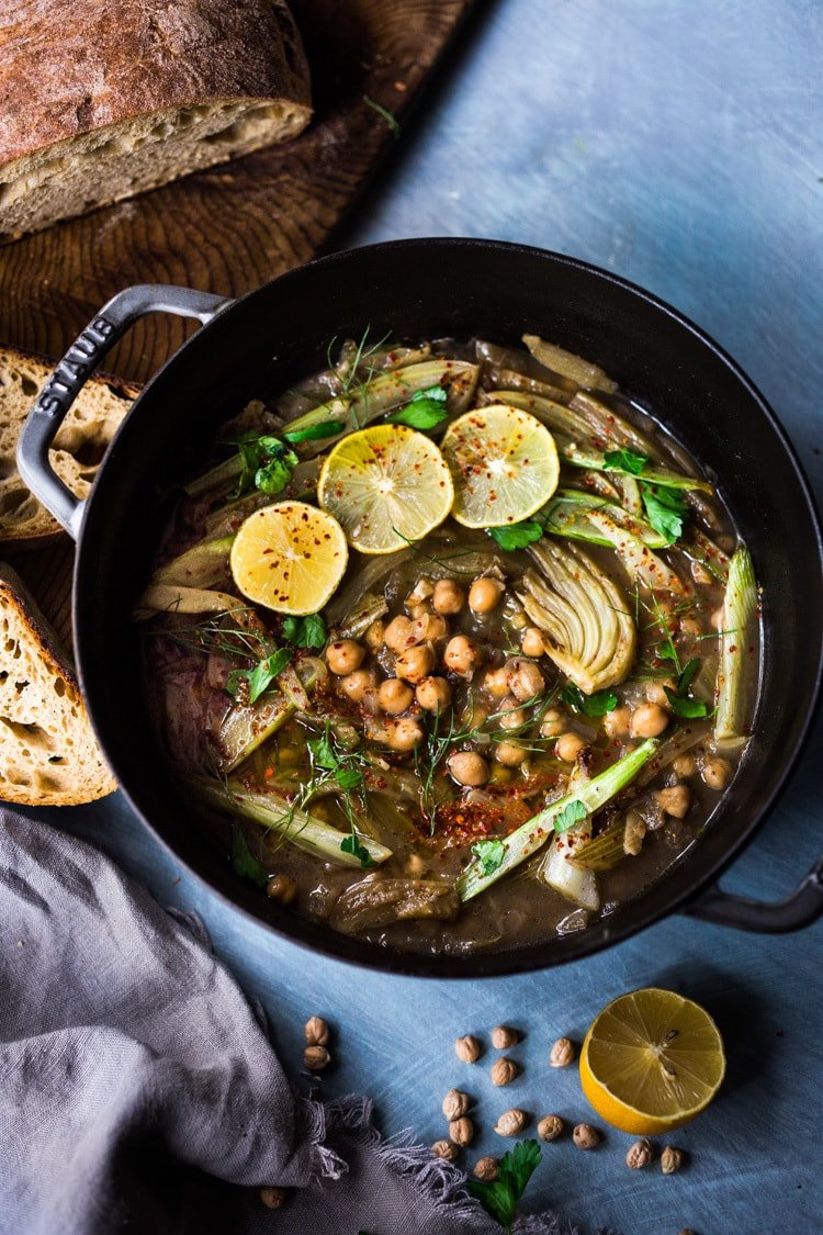 Lemony Chickpea Soup with Fennel, served over warm quinoa with flavorful Zhoug. A healthy vegan Middle Eastern-inspired soup, full of flavor! #vegansoup #chickpeasoup #chickpeastew #veganrecipes #plantbased #cleaneating #eatclean #detoxsoup