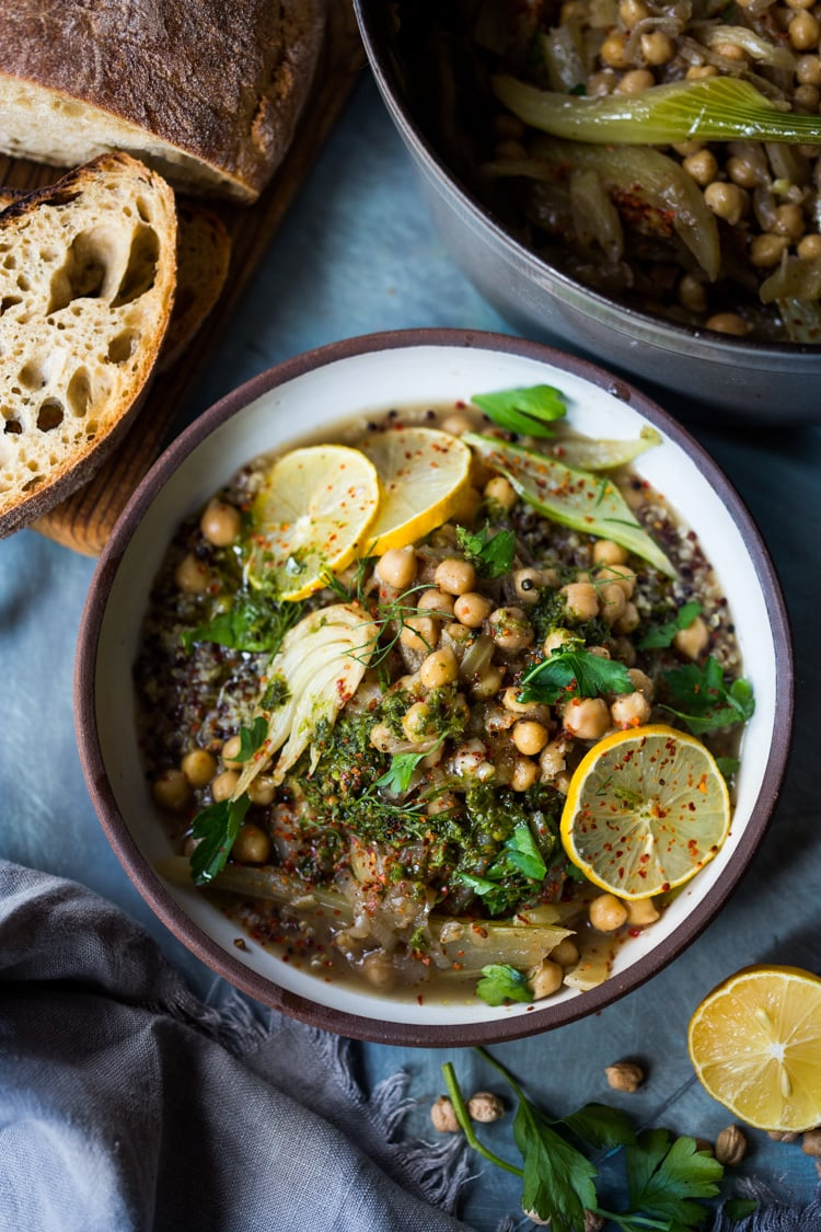 Lemony Chickpea Soup with Fennel & Sumac served over warm quinoa with flavorful Zhoug. A healthy vegan soup, full of flavor! #vegansoup #chickpeasoup #chickpeastew #veganrecipes #plantbased #cleaneating #eatclean #detoxsoup