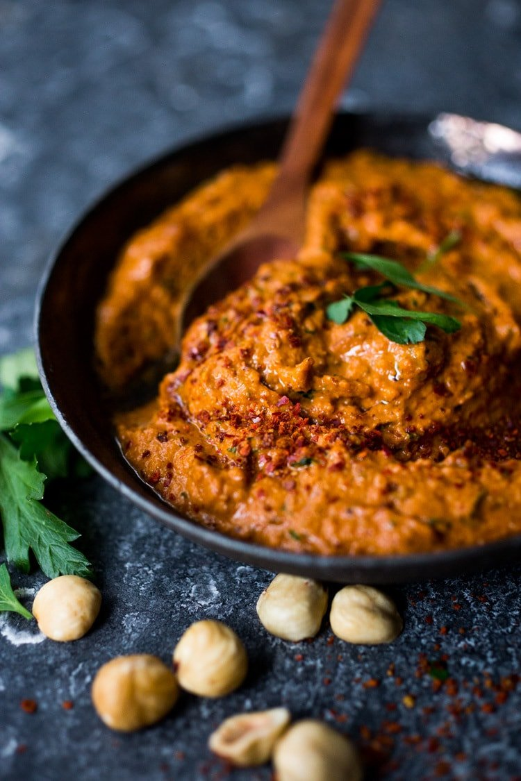 Flavorful Romesco Sauce! You'll find a million uses for this robust & flavorful Spanish condiment. Earthy, smoky and deep, it's made with simple ingredients you probably already have on hand. EASY, Vegan & Gluten-free #romesco #romescosauce #redpeppersauce #vegansauce #spanishrecipes #catalonian #spanishfood #easyromesco #plantbased #cleaneating #vegan #vegansauce