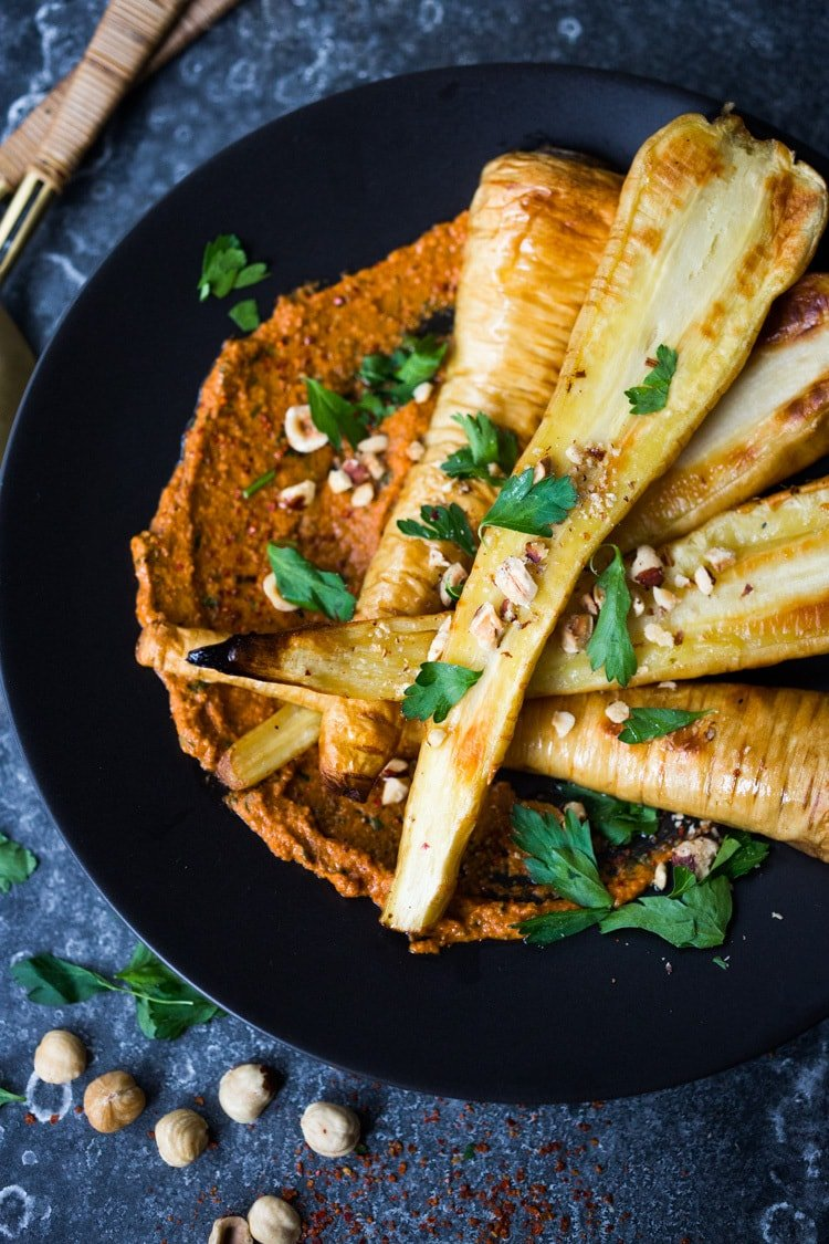 Roasted Parsnips with Romesco Sauce, a simple vegan side dish that is perfect for weeknight dinners or the holiday table! #vegan #veganside #sidedish #healthyside #parsnips #parsniprecipe #roastedparships