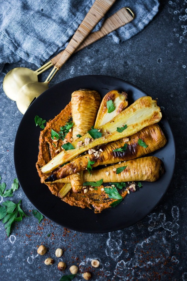Roasted Parsnips with Romesco Sauce, a simple vegan side dish or plant-based Main dish that is perfect for weeknight dinners or the holiday table! #vegan #veganside #sidedish #healthyside #parsnips #parsniprecipe #roastedparships
