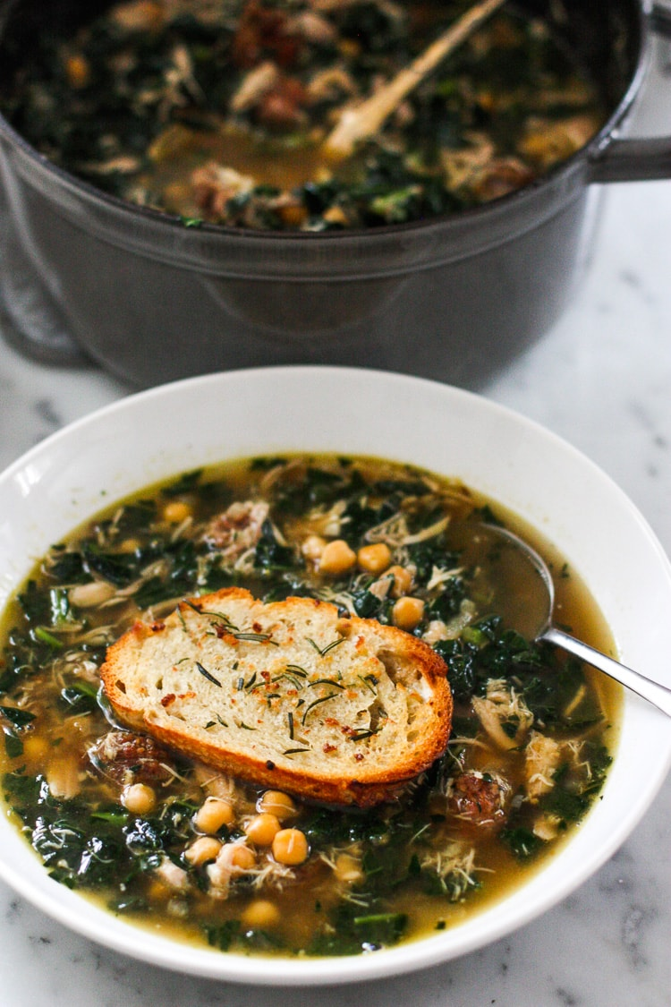 Kale, Chickpea and Chicken soup with a toasty rosemary crouton. Simple and delicious. #chickensoup #kale #chickpeasoup | www.feastingathome.com